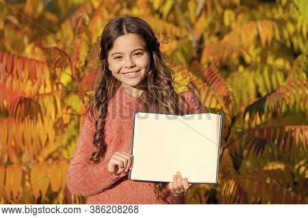 Autumn Literature Concept. Keep Studying. Small Girl Read Book On Autumn Day. Small Child Enjoy Read