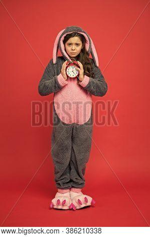 Morning Alarm. Regular Day Beginning. Adorable Bunny Hold Alarm Clock. Small Girl In Bunny Costume.