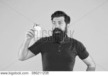 Health Is In The Balance. Health Care. Hipster Hold Plastic Container. Vitamin Complex. Handsome Bea