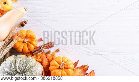 Autumn Background Decoration From Dry Leaves And Pumpkin On  Wooden Background. Flat Lay, Top View F