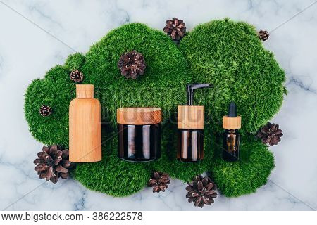 Wooden And Glass Bottles Containers Blank Mockup For Skincare Cosmetic Products On Natural Dark Gree