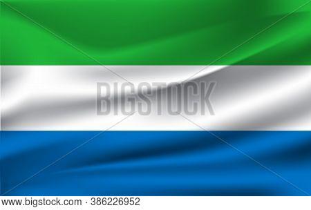 Flag Of Sierra Lrone. Realistic Waving Flag Of Sierra Lrone. Fabric Textured Flowing Flag Of Sierra