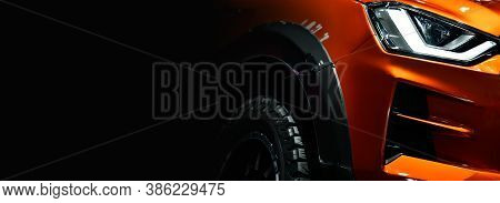 Close Up Detail On One Of The Led Headlights Orange Pickup Truck On Black Background Free Space On L