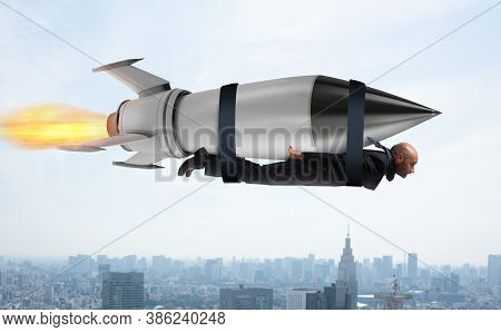 Businessman Flies With A Fast Rocket. Concept Of Ambition And Determination