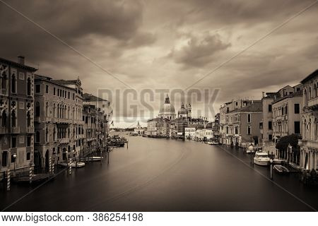 Venice  Church Santa Maria della Salute and canal in an overcast day with long exposure. Italy.