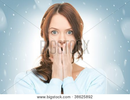 bright picture of pretty woman with hands over mouth.