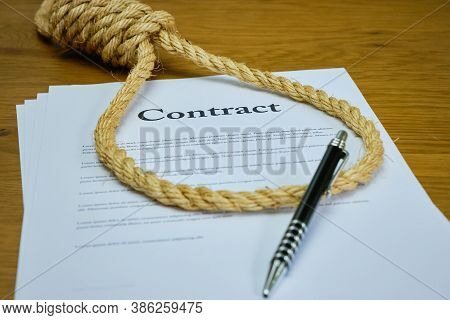 Contract With Pen And Rope Tied In Hangmans Noose. Strangulation Contract, Unfair Agreement. Lorum I