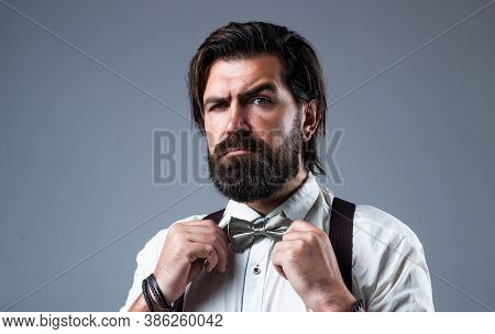 Formal Man Wear Suspenders And Fix Bow Tie Has Well Groomed Hair And Beard, Fashion And Barbershop