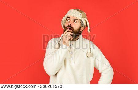Winter Sports. Thinking Hipster Wear Warm Hat. Cold And Flu. Portrait Of Brutal Man In Fleece Sweats