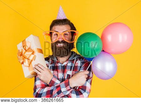 Leisure Time. Feel The Happiness. Happy Man With Beard. Man In Party Glasses Hold Balloons. Holiday