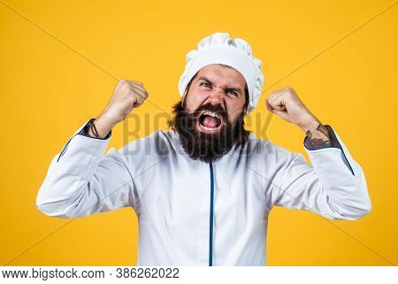 Unfriendly Look. Angry Man Shouting. Concept Of Housekeeping. Mature Bearded Man Wear Chef Hat. Male