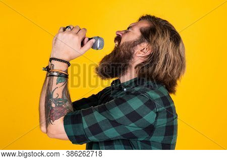 Rock Music Festival. Vocal School. Brutal And Rock. Bearded Man Wear Checkered Shirt Singing Song. M