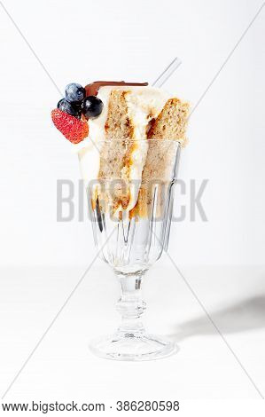 Piece Of Sponge Cake With Cream And Berries On White Background. Birthday Party Concept