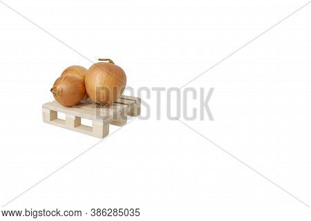 Close Up Of Three Ripe Fresh Bulb Onion On Wooden Mini Pallet Isolated On White Background With Larg