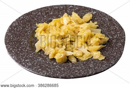 Braised Cabbage In Brown Plate Isolated On White Background. Braised Cabbage Top Side View .healthy