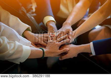 People Putting Their Hands Together. Friends With Stack Of Hands Showing Unity And Teamwork. Busines