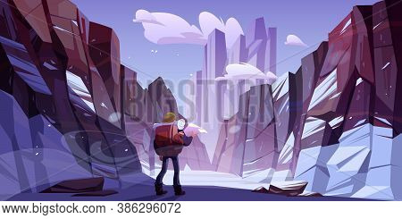 Traveler Man At Winter Mountains, Travel Journey, Adventure. Tourist With Backpack And Map Stand At