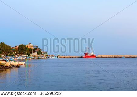 Pomorie, Bulgaria Beachfront Sea View With Boats, Promenade Houses In The Town And Seaside Resort On