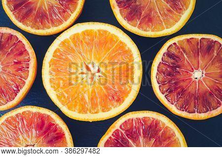 Sliced Blood Oranges Texture. Citrus Background. Cut Ripe Juicy Sicilian Blood Oranges Fruits On Bac