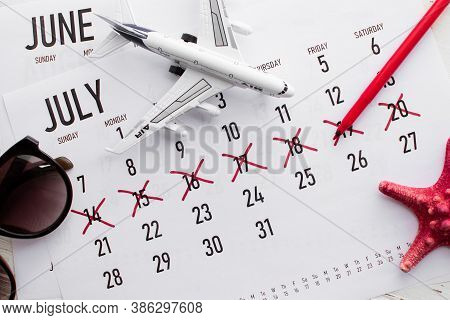 Vacation Planning Concept. Travel Preparation: Vacation Plan Written On Calendar And Sunglasses On W
