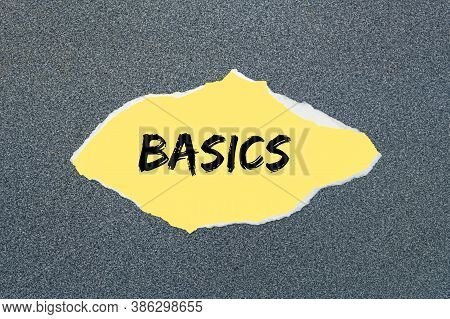 Basics - Written On Torn Yellow Paper. Gray Background