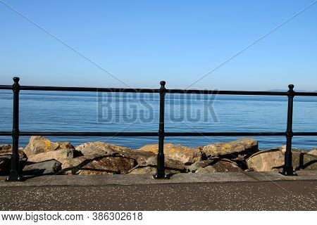 Handrail At A Pedestrian Seaside Promenade Walkway