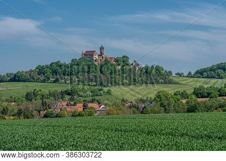 View On Ronneburg Castle In Hesse, Germany With Green Foreground During Summertime