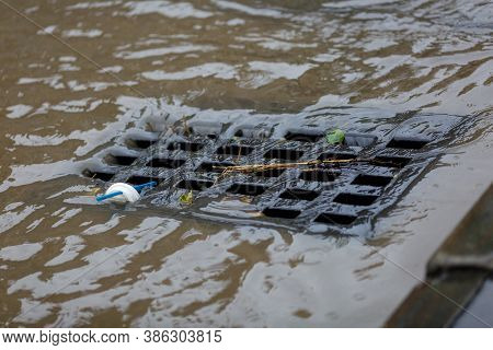Dirty Rainwater Drains Into A Road Rain Storm