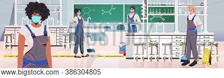 Professional Cleaners Mix Race Janitors Team Cleaning And Disinfecting School Chemical Classroom Cor