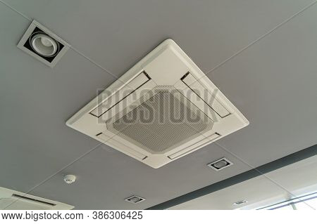 Modern White Ceiling Mounted Cassette Type Air Conditioner In Office Building System Work. Ventilati