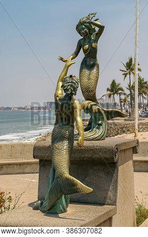 Puerto Vallarta, Mexico - April 25, 2008: Malecon Boardwalk Along Ocean. Triton Adn Nereida Mermaid