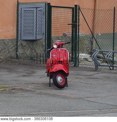 Turin, Italy - Circa September 2020: Red Italian Piaggio Vespa Scooter Motorcycle