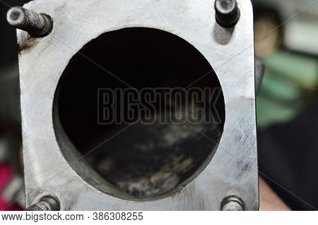 Bottom View Of A Part Of The Exhaust Manifold Of A Diesel Engine After Cleaning From Soot