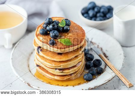 Pancakes With Blueberries And Honey On A Plate. Breakfast Pancakes Stack With Berries