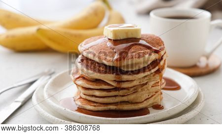 Pancakes With Butter And Maple Syrup On A Plate. Tasty Sweet Breakfast Food