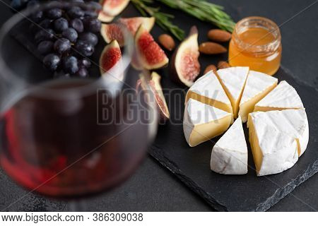Wine, Brie Cheese And Figs. Appetizer Plate With Cheese And Glass Of Red Wine