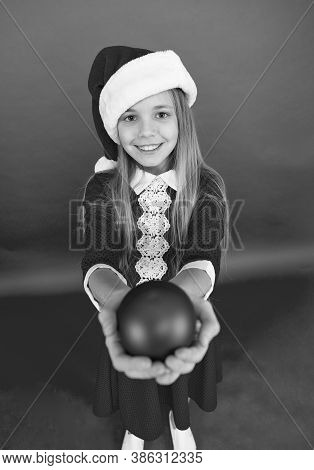 For You. Happy Child Red Costume Hold Christmas Ornaments Close Up Selective Focus. Shop For Decorat