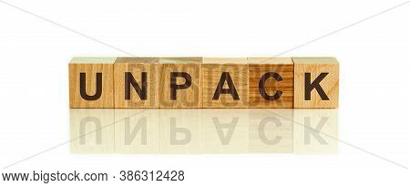 Modern Business Buzzword - Unpack. Word On Wooden Blocks On A White Background. Close Up.