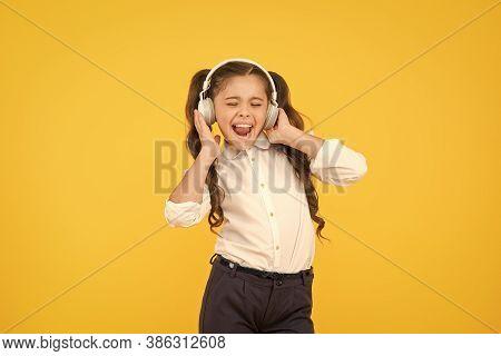 Child Enjoy Music Sound. Audio Schooling. Home Schooling. Small Girl Pupil Headphones. Child Happy L