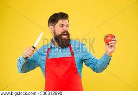 Hungry, Why Wait. Hungry Hipster Cut Tomato With Knife. Suffering Hunger. Healthy Diet And Dieting.
