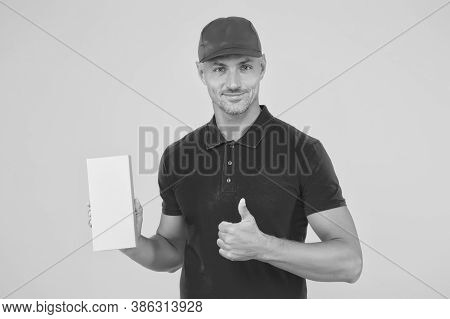 Perfect Delivery. Delivery Man Hold Box Yellow Background. Package Boy Give Thumbs Up In Red Uniform