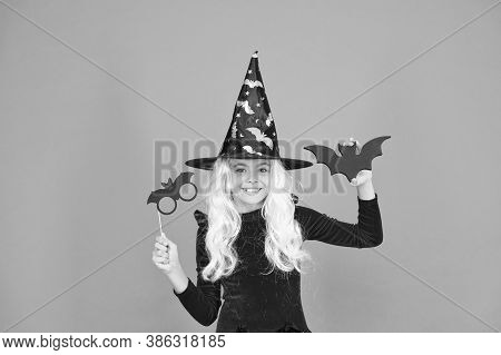 Curse Spell. Little Girl Cast Magic Spell Orange Background. Wicked Witch Spell. Magic And Witchcraf