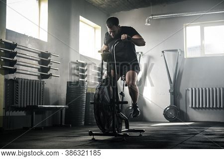Active Male Has Workout On Stationary Bike .