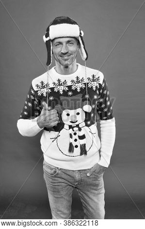 Good Luck. Handsome Man Celebrate Winter Holidays Red Background. Guy Wear Winter Sweater. Merry Chr
