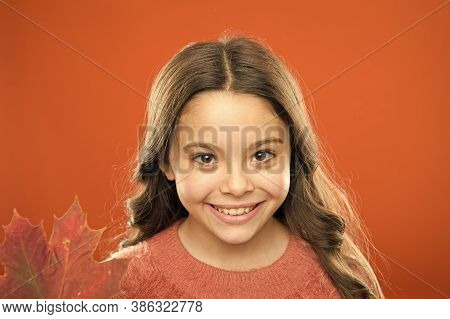 Small Girl Smile With Maple Leaf. Maple Syrup Often Used As Condiment For Pancakes Waffles Or Porrid
