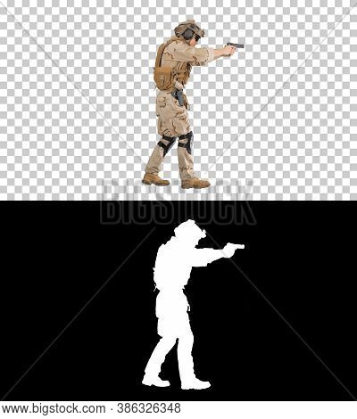 Armed Soldier In Camouflage Walking And Aiming With A Hand Gun,