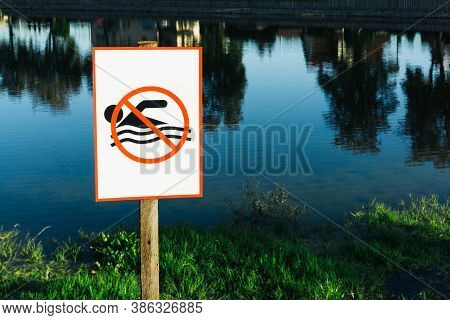 No Swimming Sign. Entering Water Is Forbidden. Safety Lake Shore Restrictions. Shallow Water Danger