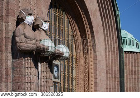 Helsinki, Finland - 16 August 2020: Iconic Stone Men Statues By The Side Of The Entrance To The Hels