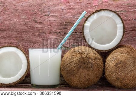 Coconut And Glass With Coconut Water. Coconut Water Is A Sweet-tasting Liquid Present Inside The Fru