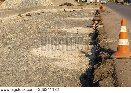 Curb Formation And Traffic Cones At The Edge Of The Carriageway, Selective Focus